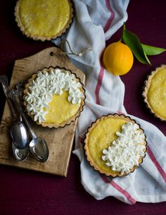 """lemon, orange or lime tarts, my fave - love how the """"flowers"""" of whipped cream was piped onto parts of each individual tart"""