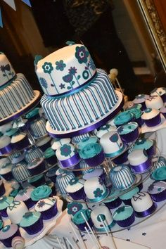 Purple and turquoise wedding cake with cupcake tiers