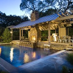 double sided fireplace overlooking pool
