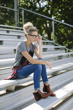 Hipster back to school outfit inspiration featuring jeans, brown boots, flannel and the softest lion t-shirt you'll ever wear!