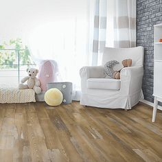 Brown, medium wood-look flooring.  Pergo Extreme Wood Originals in Morning Lake House