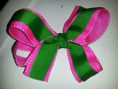 Hot pink and green bow sold at beccas little designs on facebook for $4!
