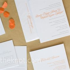 Wendy designed the programs herself and embellished them with orange satin ribbon. To save money and stress, the couple used the same materials bought in bulk to create many of the details of the wedding.