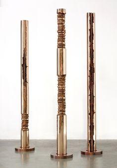 Arnaldo Pomodoro three bronze sculptures