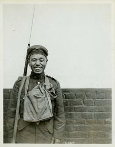 A Canadian Japanese soldier wearing a captured German cap, c. 1917.