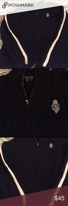 Zip up sweater Cotton Ralph Lauren zip up sweater. Has navy with white stripe down the sleeves. Gold zipper( top / bottom zip). RL logo on the front. Very nautical feel for spring or cool summer nights on the boat! Lauren Ralph Lauren Tops Sweatshirts & Hoodies