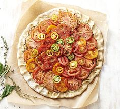 A quick and simple tin-free tart with vibrant tomato topping and homemade cheddar and Parmesan pastry