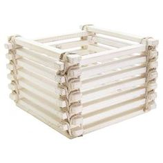 Weathered wood basket with slatted sides.