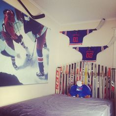 """NY Rangers Themed bedroom complete with """"retired"""" jerseys over the hockey stick headboard. Rangers Hockey, Hockey Mom, Bedroom Themes, Bedroom Ideas, Bedrooms, Hockey Bedroom, New York Rangers, Boy Room, Projects To Try"""