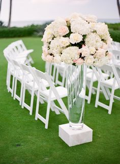Clear+vase+topped+with+ivory+flower+arrangement