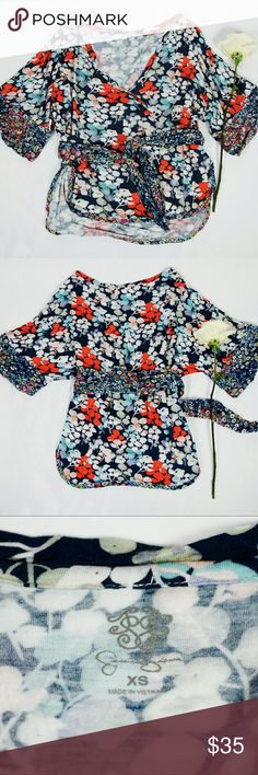 [Jessica Simpson] Bess Kimono Wrap Top Jessica Simpson Bess kimono wrap top in beautiful floral print. V-neck with kimono style sleeves. Contrast floral print on the sleeve cuffs and on the tie waist. Notched sides that come up to the mid waist. Size XS. Pre-loved in excellent condition. Only worn a few times. Tops