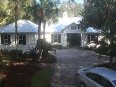 See progress pics of the St. Simons Island home under construction, including the big backyard transformation.