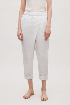 COS image 2 of Overlap cotton trousers in Light Grey