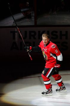 Daniel Alfredsson #11 of the Ottawa Senators acknowledges the fans prior to the ceremonial puck drop the day he announced his retirement, 12/04/2014