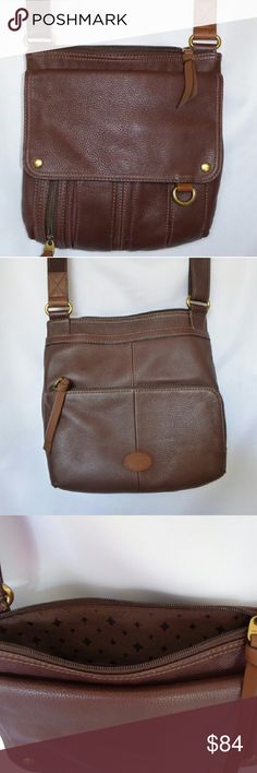 """Fossil Morgan Traveler Fossil Morgan Traveler in espresso, is a luxurious leather bag that's sleek and compact.  Flapover closure, and top zip closure. Signature print lined interior that includes cell phone pocket, zip pocket, and tablet pocket.  An additional zip pocket with key ring, open back pocket, and adjustable straps with drop length of 21"""".  Maybe worn as shoulder or crossbody bag. Very gently used, looks practically new. Thank you for your interest. Have a great day! Fossil Bags…"""