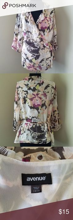 Cream Colored Silk Wrap Blouse, 14 Cream colored silk wrap blouse with lime, charcoal and mauve floral detail and 100% polyester lining. Size 14 by Avenue. Avenue Tops Blouses