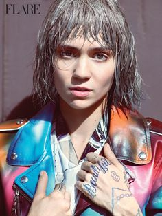 Grimes wears mesh tops to a rainbow-colored moto jacket Pose for Flare Magazine winter 2015 Photoshoot