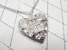Police Box Heart Shaped Locket, inspired by Doctor Who and the TARDIS. Perfect for a whovian Valentine!  http://www.pinznthingz.com/collections/inspired-by-doctor-who/products/police-box-heart-shaped-locket-inspired-by-doctor-who-and-the-tardis