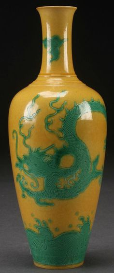 A CHINESE PORCELAIN GREEN GLAZED ON YELLOW GROUND DRAGON BOTTLE VASE. Height 9.25 inches (23.5 cm).