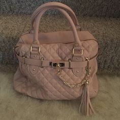 Pink blush Steve Madden bag Bag is like new comes with a shoulder strap , has a cute tassel on front Steve Madden Bags Shoulder Bags