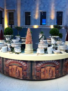 Rethinking concrete garden urns and pots. Unused of course....Roman food station by Alison Price and Company
