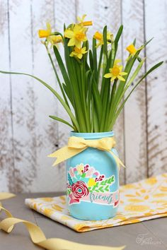 Spray paint and Decorate mason jars with Silhouette Vinyl Decals to create a beautiful plant pot.  Perfect crafty gift idea