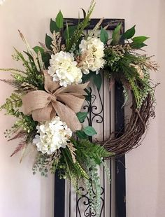 Beautiful IVORY WHITE HYDRANGEA GRAPEVINE WREATH for your front door. All season, any season, year round wreath. Farmhouse everyday wreath. 18 Grapevine base, accented with Ivory hydrangeas, dark green leaves/foliage, greenery & feather picks. Finished off with a beautiful burlap bow. Completed Greenery Wreath, Hydrangea Wreath, Burlap Flowers, Summer Door Wreaths, Wreaths For Front Door, Easter Wreaths, Spring Wreaths, Front Porch, Santa Wreath