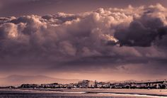 CLOUDING OVER By Peter Domican LRPS  Tail of cloud formation passing over Narbonne, France