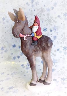 Hand carved Santa riding moose by Susan M. Smith