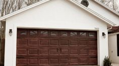 Transform your garage door to a gorgeous faux wood door with this easy gel stain DIY garage door makeover! We've been dreaming up garage door makeover ideas since we first purchased our home, and though we've … White Garage Doors, Metal Garage Doors, Garage Door Paint, Garage Door Colors, Garage Door Hardware, Garage Door Styles, Garage Door Makeover, Garage Door Design, Faux Wood Garage Door Diy
