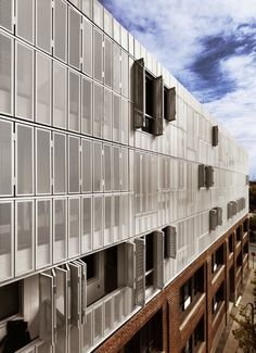 The urban housing project, Irène, located in Montreal's borough, St-Henri, exemplifies innovation as a valuable design tool to individualize a building within the City. Perforated aluminium panels were customized into. Facade Architecture, Residential Architecture, Chinese Architecture, Commercial Architecture, Futuristic Architecture, Modern Shutters, Retail Facade, Double Skin, High Rise Building