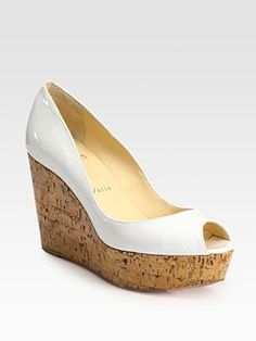 Christian Louboutin  Patent Leather Cork Wedge Pumps   $625.00