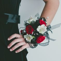 Beautiful and classic prom corsage. The red, white, and black colors pop so well together. It's a stunning addition to the perfect prom dress. Design by The Front Porch Flowers & Gifts. Black Corsage, Red Corsages, Prom Corsage And Boutonniere, Boutonnieres, Homecoming Flowers, Homecoming Corsage, Prom Flowers, Wedding Flowers, White Tuxedo Wedding