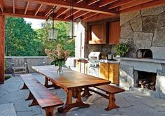 Serving up gourmet pizza and big views, this stone-laden cooking and entertaining space can cater to a crowd