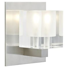 The Tech Lighting Cube Wall Sconce uses simple geometry to create a burst of dramatic ambient and uplighting. The shade is a cube of transparent pressed glass with a frosted interior that diffuses the light into a soft, welcoming glow. Available in a variety of colors and metal finishes to coordinate with any surrounding contemporary decor.
