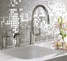 Stainless steel mosaic backsplash LOVE LOVE LOVE!  possibly for the laundry room??? Or a girls bath?