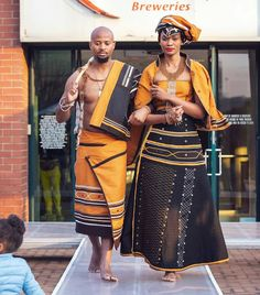 Couple In Beautiful Orange and Black Xhosa Umbhaco Traditional Attire - Clipkulture Couple In Beautiful Orange and Black Xhosa Umbhaco Traditional Attire South African Fashion, Latest African Fashion Dresses, African Print Dresses, African Print Fashion, Africa Fashion, African Dress, African Wedding Attire, African Attire, African Wear