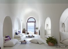 The living area of Costis Psycha's home on the Greek island of Therassia overlooks the Aegean Sea.   - ELLEDecor.com