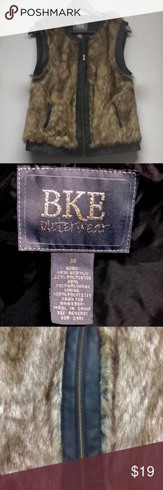 BKE OUTERWEAR Faux Fur Vest w Faux Leather Trim As pictured, pre-owned item in Very Good condition with no structural flaws noted. Great refined savage look. BKE Outwerwear Jackets & Coats Vests