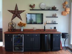 Bar with kegerator & wine fridge. Stock pine cabinets painted and reclaimed oak countertops.