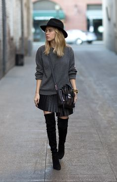 Black hat, grey sweater, leather pleated skirt, overknee boots