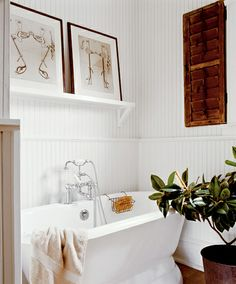 Classic white bathroom + striped wallpaper + wood accents