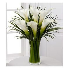Calla Lily Bouquet is an extraordinary display of these exquisite white blooms. Gorgeous and bright, our finest full-sized white calla lilies capture the essence of beauty and sophistication accented by lush palm leaves Arrangements Ikebana, Church Flower Arrangements, Beautiful Flower Arrangements, Flower Centerpieces, Flower Vases, Flower Decorations, Floral Arrangements, Wedding Centerpieces, Centrepieces