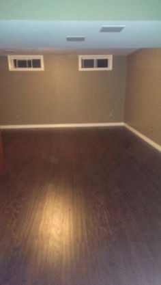 Wonderful Basement With Hand Scraped Laminate Flooring By Entrypoint Kw