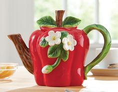 Apple Teapot ... red, with applied apple blossom flowers, stem & leaves as knob, branch handle and spout, ceramic