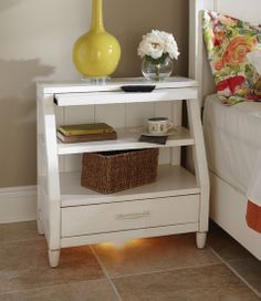 Love this White painted nightstand with pull out, shelves and one drawer.