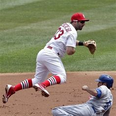 St. Louis Cardinals second baseman Daniel Descalso leaps over a sliding Los Angeles Dodgers' Andre Ethier after throwing to first to get Hanley Ramirez and complete the double play in the second inning of a baseball game, Thursday, July 26, 2012, in St. Louis. (AP Photo/Tom Gannam)