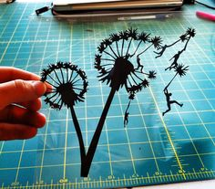 Dandelion with People Hand-Cut Paper Silhouette