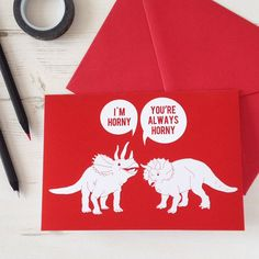 Funny little red card for something a bit different this valentines day. Two horned triceratops dinosaurs - one more horny than the other.