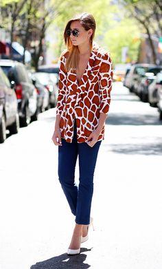Bright giraffe-print blazer, tailored denim and white pointed-toe pumps